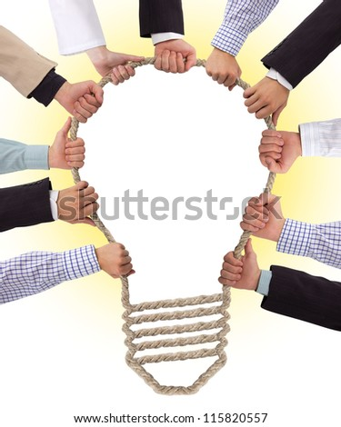 Hands holding rope forming puzzle