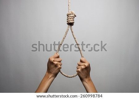 Hands holding rope slipknot in concept suicide