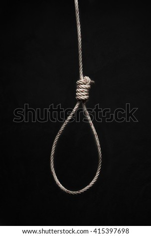 Hands holding rope slipknot in concept suicide - stock photo