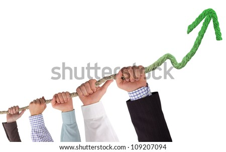 Hands holding rope, with green arrow, concept of growth - stock photo