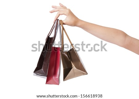 hands holding shopping bags