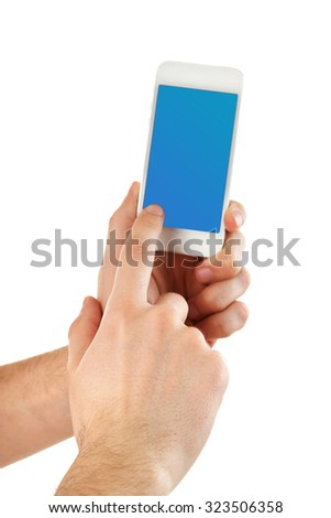 Hands holding smart phone with blue screen, isolated on white