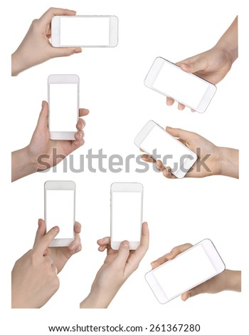 Hands holding smart phones isolated on white - stock photo