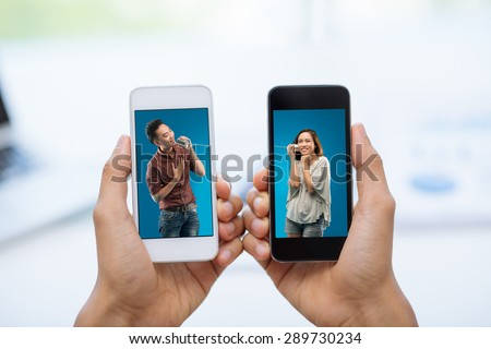 Hands holding smartphones with photos of couple talking via tin phone: communication concept