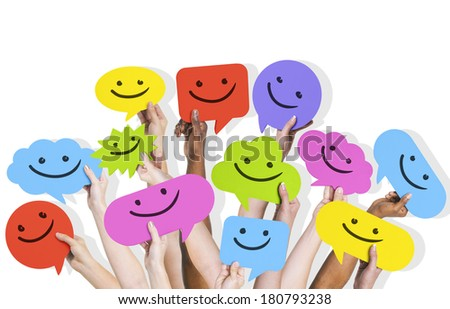 Hands Holding Smiley Faces Speech Bubbles - stock photo