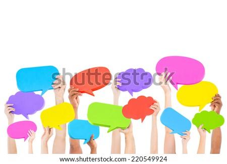 Hands holding speech bubbles. - stock photo
