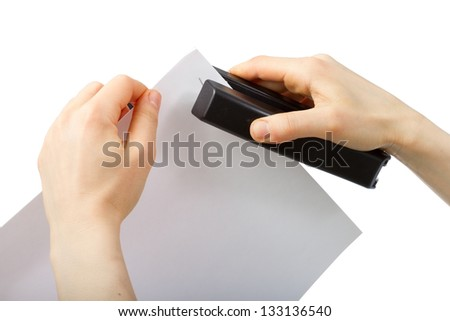 Hands holding stapler and paper isolated on white background - stock photo