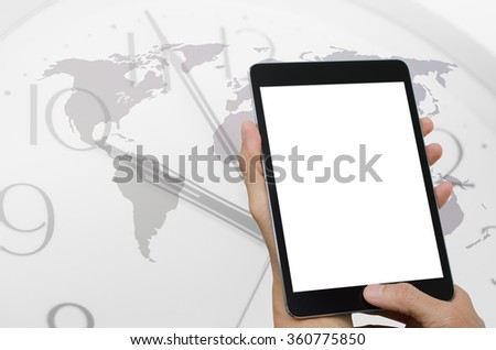Hands holding tablet computer, clock and world map background, world wide connection concept. - stock photo
