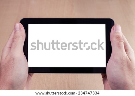 Hands holding tablet PC. - stock photo