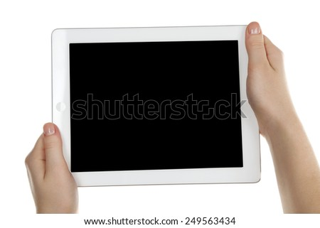 Hands holding tablet PC isolated on white - stock photo