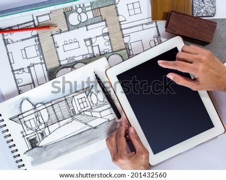 Hands holding tablet with architecture drawing and material sample,  concept of home renovation - stock photo