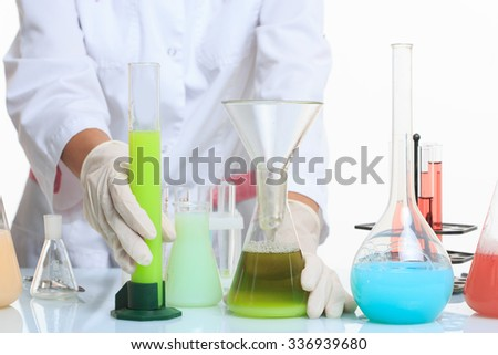 hands holding test tubes with chemical elements.  - stock photo