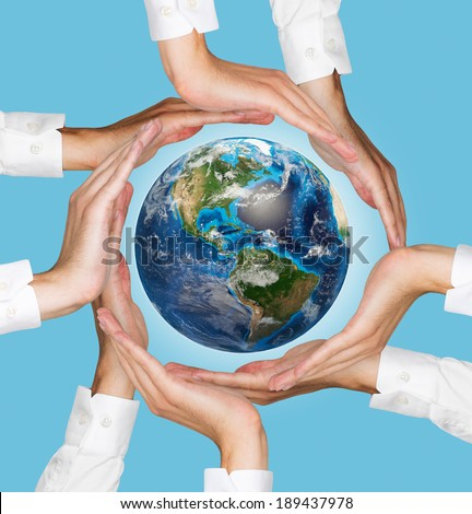 Hands holding the earth, blue background. Elements of this image furnished by NASA.