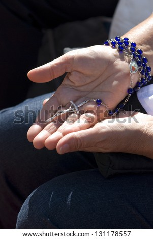 Hands holding the Rosary