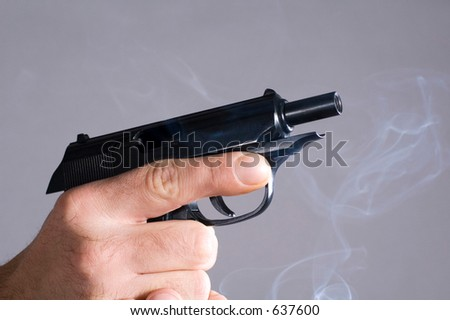 Hands holding the unloaded pistol - stock photo