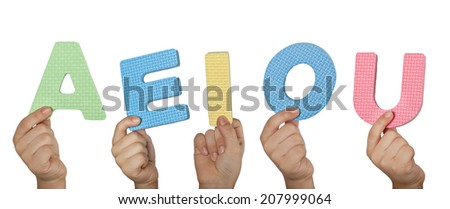 Hands holding the vowel letters of the English alphabet  - stock photo