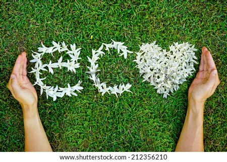 hands holding the white flowers arranged as a word eco - stock photo