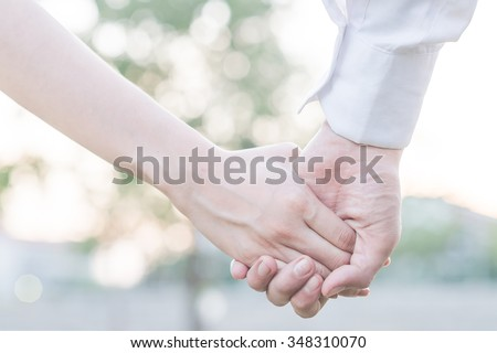 hands holding together for cheerful healing love - stock photo