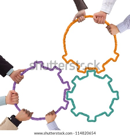 Hands holding tooth wheels, teamwork concept - stock photo