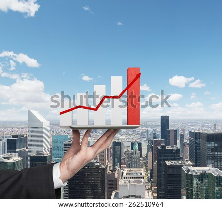 hands holding touch pad with stock chart - stock photo