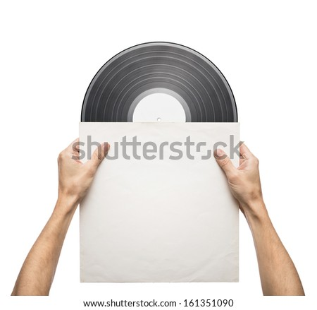 Hands holding vinyl record in a paper case - stock photo