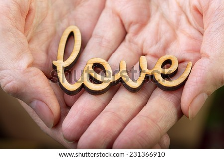 hands holding word love