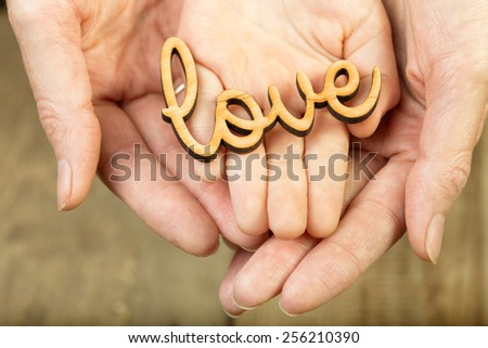 hands holding word love - stock photo