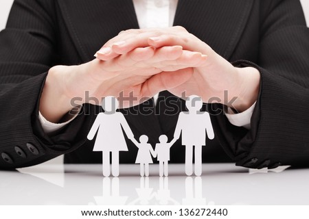 Hands hug the family (concept) - stock photo