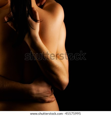 Hands hugging a girl in passion - stock photo