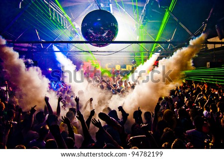 Hands In Air Rave With Smoke Machine and Laser Crowd - Nightclub - stock photo