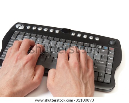 Hands in front of a compact black keyboard, on the home row, isolated on white.