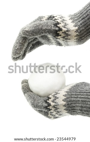 Hands in gloves holding snowball - stock photo