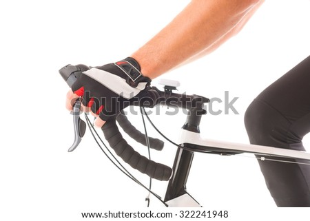 Hands in gloves on bicycle's handlebars - stock photo