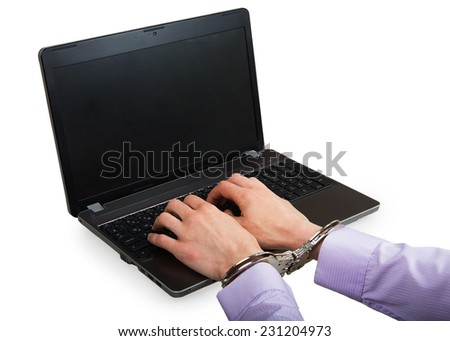 Hands in handcuffs on a laptop isolated on a white background