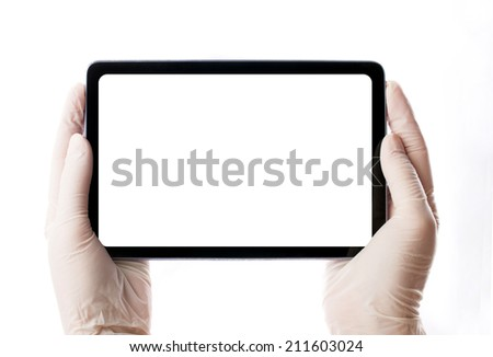 hands in medical gloves holding tablet with black monitor on white background  - stock photo