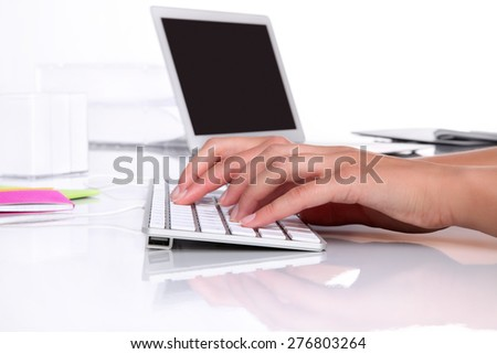 hands in office desk typing on keyboard - stock photo