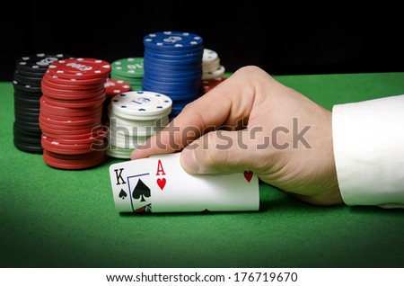 Hands in the foreground with ace and king  - stock photo