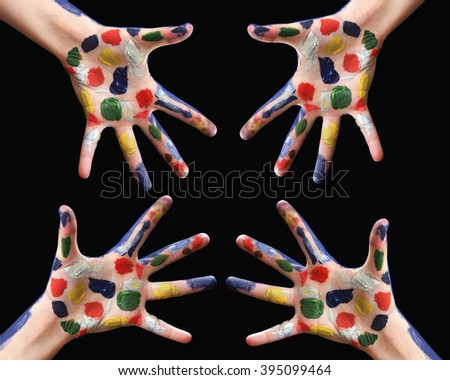 Hands in the paint. Greeting. The hands are drawn to each other. Handshake. Conceptual. Black background. Bright colors. Spot color ink on the palms. Many hands - stock photo
