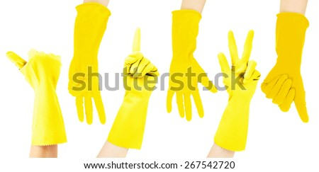 Hands in yellow gloves gesturing numbers isolated on white - stock photo