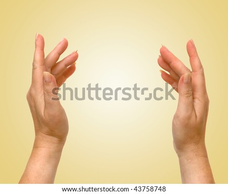 Hands isolated on yellow background
