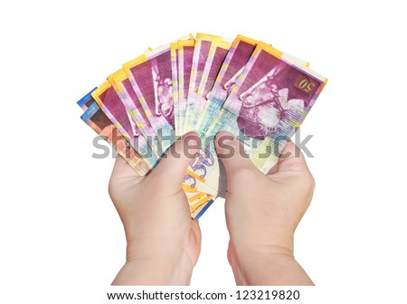 Hands keep banknotes (Shekel israeli) isolated on a white background. - stock photo