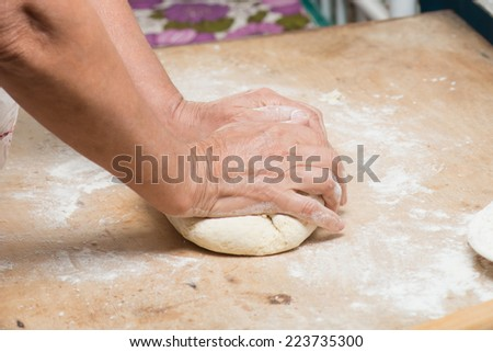 hands knead bread