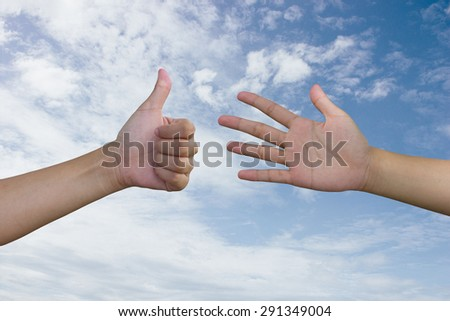 Hands like and ignore the background sky. - stock photo