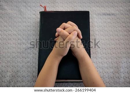 hands little girl praying. - stock photo
