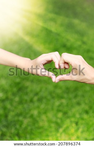 hands love together of Mom and her daughter - stock photo