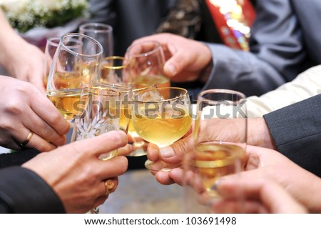 hands make cheers with glasses of champagne - stock photo