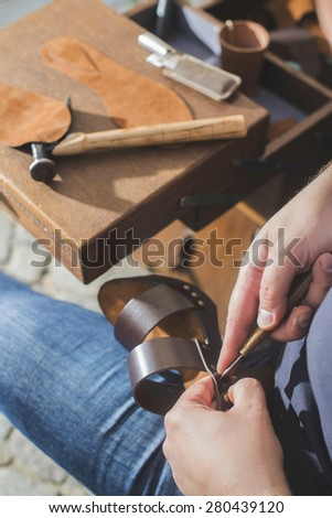 Hands making shoes. Shoemaker - stock photo