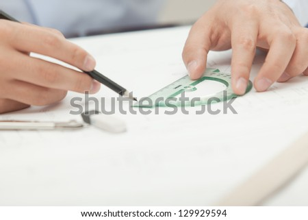 Hands male architect to make drawings using various line pencil and compass