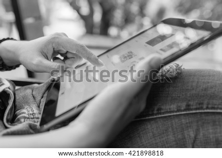 hands multitasking woman using tablet. tablet can connect to Wi-Fi. tablet to watch movies. tablet users play games. Girl using tablet.  The new tablet. Black color tablet. - stock photo
