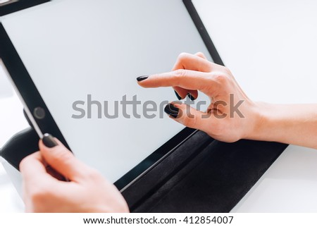 Hands of a business lady working with a tablet , side view closeup mock up